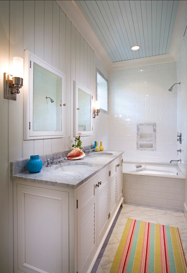 Bathroom. Bathroom Ideas. Coastal bathroom with painted blue ceiling and beadboard walls. Bathroom.