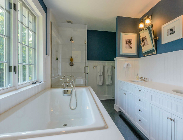 Bathroom. Bathroom Ideas. Navy Blue bathroom with wainscotting and classic design details. #Bathroom