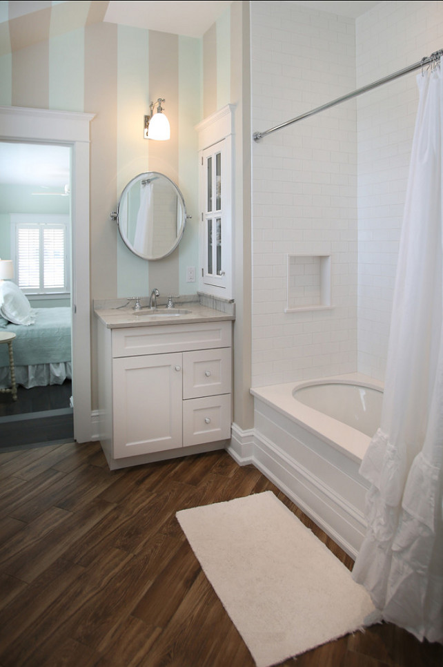 Bathroom. Bathroom Ideas. Small bathroom Ideas. This guest bathroom is on the smaller size and it's full of personality with great flooring, subway tiles and stripe painted walls. #Bathroom #BathroomIdeas #SmallBathroom