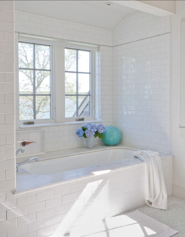 Bathroom. Bathroom Ideas. White Bathroom with subway tiles and marble flooring. #Bathroom