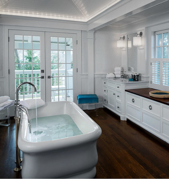 Bathroom. Bathroom with freestading bath, marble countertop and hardwood floors. #Bathroom #BathroomDesign #BathroomIdeas Designed by Sean O'Kane AIA Architect P.C. - Photo by Barry A. Hyman