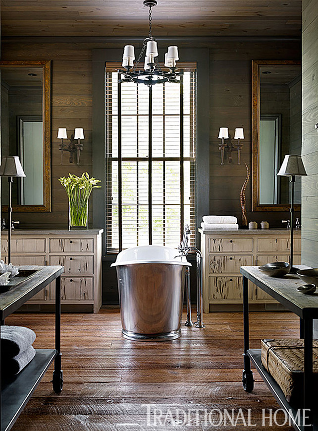 "Bathroom. Master Bathroom Design. The ""Margaux"" tub from Waterworks is centered between twin vanities in the master bathroom. #Bathroom #MasterBathroom #BathroomIdeas #RusticBathroom"