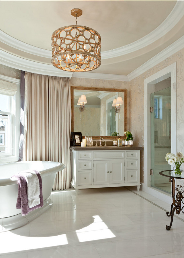 Bathroom. Master Bathroom Ideas. A marble-clad master bath that features custom cabinetry, a custom chandelier of crackle leaf finish over gilded metal and mother-of-pearl accents.