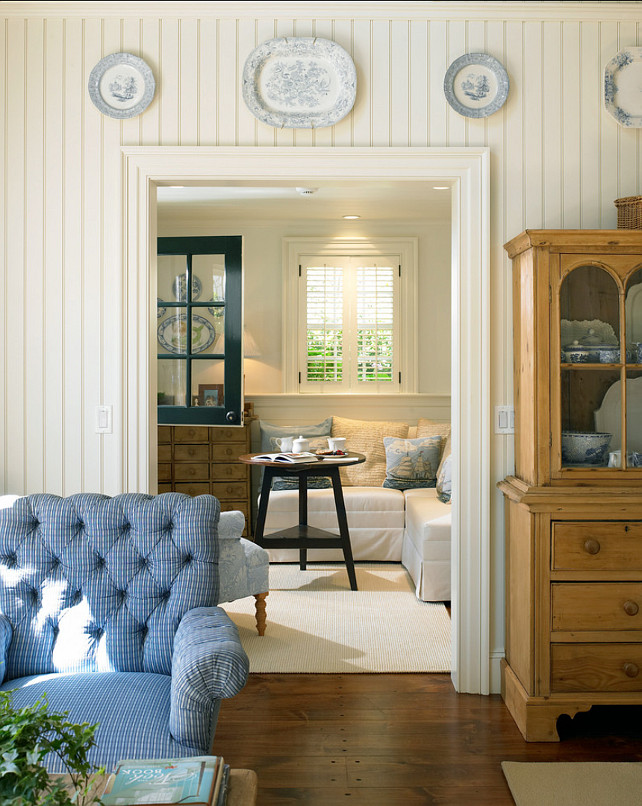 Coastal Living Room. Coastal living room with classic decor and beadboard wall panelling. #Livingroom #CoastalInteriors #Coastaldecor #Classicinteriors