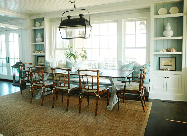 Dining Room. Turquoise Dining Room with Banquette. Cottage dining room built-in cabinets with turquoise blue beadboard backsplash and beachy accents. Built-in dining room banquette, wicker dining chairs and blue banquette pillows. Dining Room Ideas. Morrison Fairfax Interiors