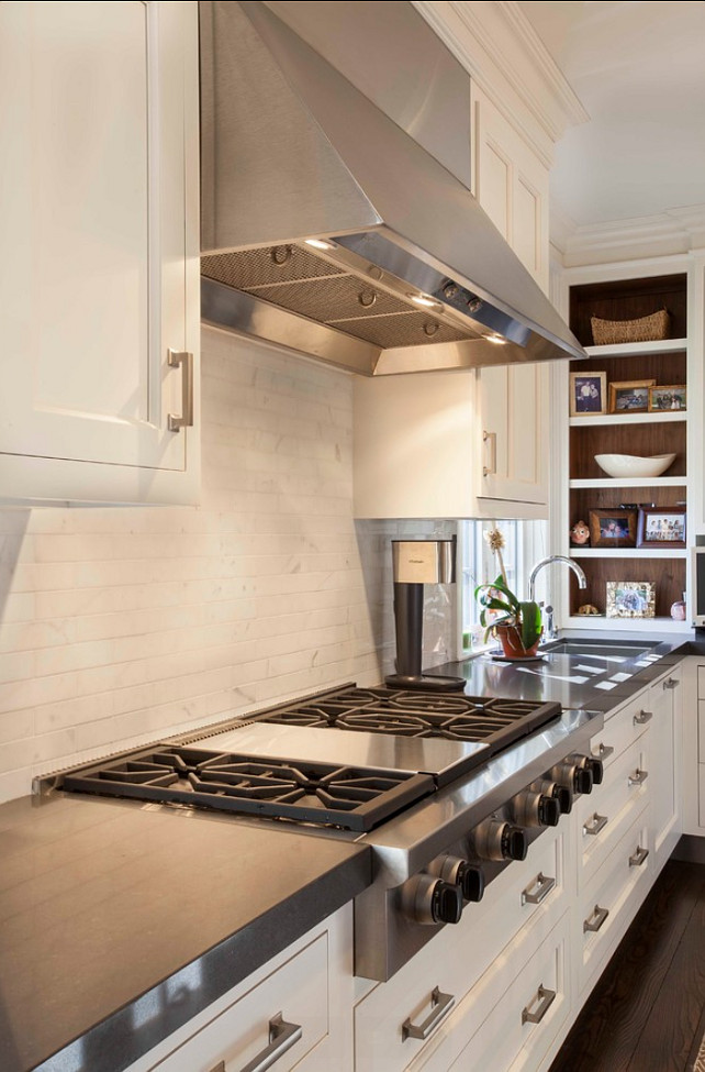 Kitchen Design Ideas. Kitchen Hood, Kitchen Cooktop, Kitchen Backsplash, Kitchen Cabinets. The countertop in this kitchen is Cesarstone. #Kitchen #KitchenIdeas #KitchenDesign Designed by John Johnstone Kitchen & Bath Designers.
