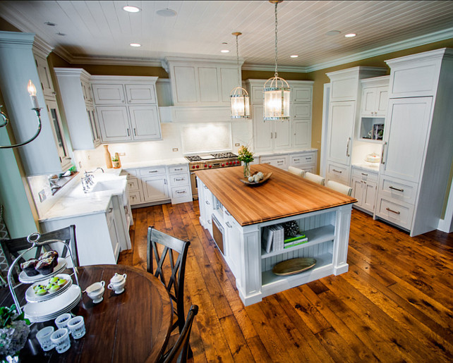 Kitchen Design Ideas. Spacious white kitchen design ideas. Hardwood floors are antique heart pine with a dark stain. #Kitchen #KitchenIdeas #SpaciousKitchen #Whitekitchen