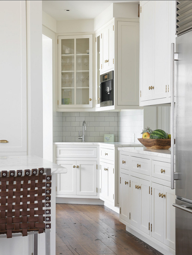 "Kitchen Hardware. Kitchen with brass hardware. Kitchen Cabinet Hardware. The cabinets are shop painted with ""Benjamin Moore 968 Dune White"". The cabinets are shop painted with ""Benjamin Moore 968 Dune White"". Walls match in Matte finish. Hardware is from ""Colonial Bronze"". #Kitchen #KitchenHardware #KitchenCabinetHardware"