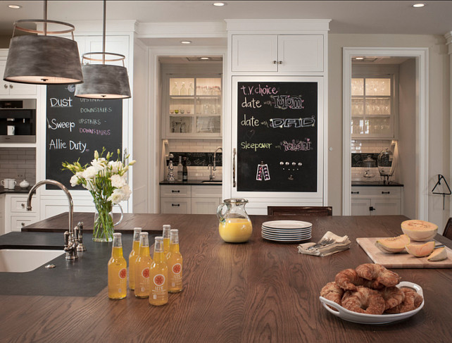 Kitchen Ideas. There are great ideas in this kitchen. Countertop is butcher's block on the island. Note the chalkboard paint on the cabinets. #Kitchen #KitchenIdeas