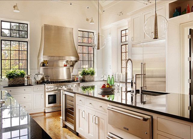 Kitchen Island Ideas. Huge kitchen island and granite countertop. Pendants above the island are Caviar large polished nickel clear glass pendants from Arteriors. #Kitchen #KitchenIsland Rufty Custom Built Homes and Remodeling.