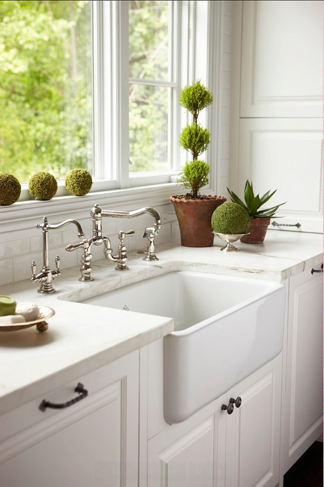 Kitchen Sink. Farmhouse sink. A beautifully integrated farmhouse sink is surrounded by immaculate white marble and flanked by integrated Dishwasher. #Kitchen #Sink