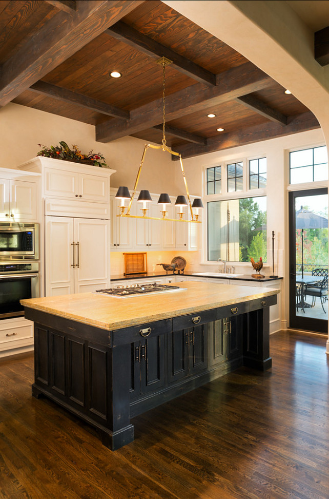 Kitchen. French Kitchen. French kitchen with rustic reclaimed beam ceiling and large island. #FrenchKitchen #FrenchInteriors #FrenchDesign #FrenchHomes #Kitchen. Designed by Kyle Hunt & Partners, Incorporated.