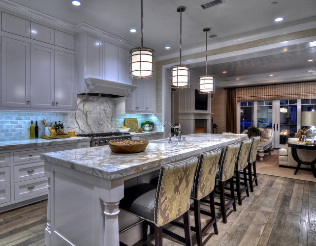 "Kitchen. Kitchen Ideas. White Coastal Kitchen Design. Pendant Lighting are from Visual Comfort. Ikat fabric on the back of the stool is the ""Kelly Wearstler Bengal Bazaar in Murshroom/Straw GWF-2811-614 for Lee Jofa"".#Kitchen #CoastalKitchen #KitchenDesign"