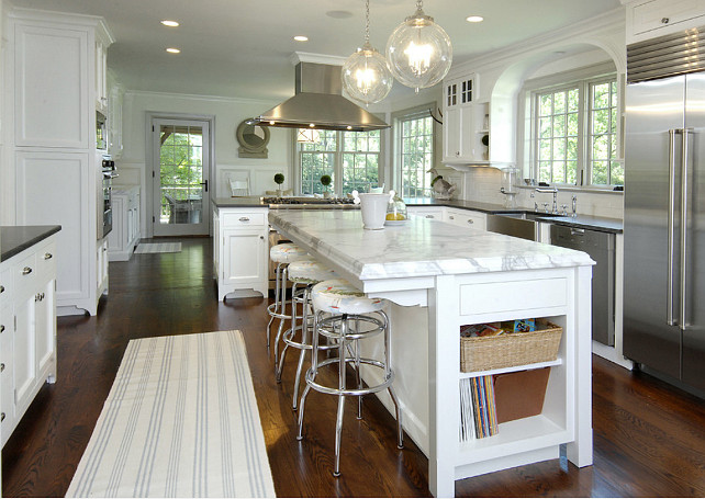 "Kitchen. White Kitchen Ideas. Traditional White kitchen with stainless appliances and white marble countertop. Pendant is the ""Sorenson Pendant from Remains"". #Kitchen #WhiteKitchen #KitchenIdeas."
