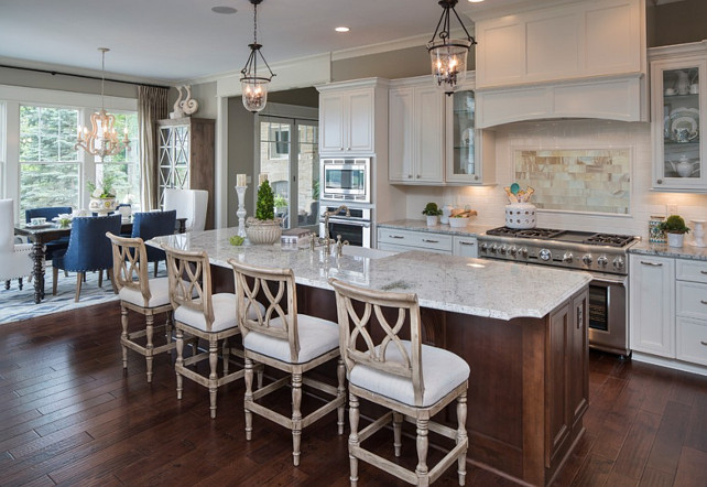 "Kitchen. White kitchen with open floor plan. The island counterstools are from ""Ballard Designs"". They are the ""Montgomery Counterstool"" in the aged driftwood oak and linen finish. Kitchen with Granite Countertop: The granite color in this kitchen is called ""Cotton White"". WhiteKitchen #OpenFloorplanKitchen"