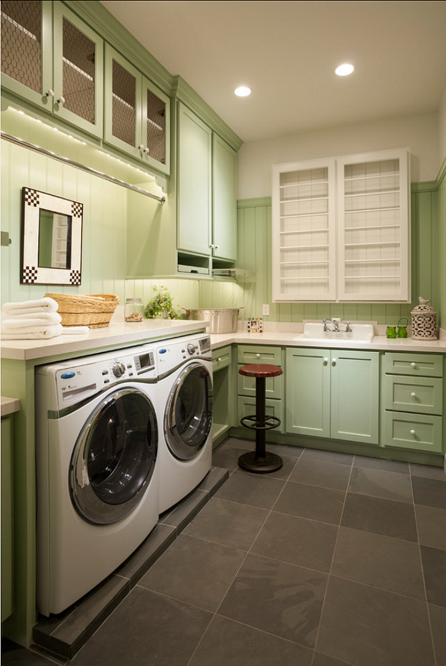 Laundry Room. Laundry Room Ideas. Laundry room with custom cabinets, storage space and drying rack. Laundry Room Design. THINK architecture Inc.