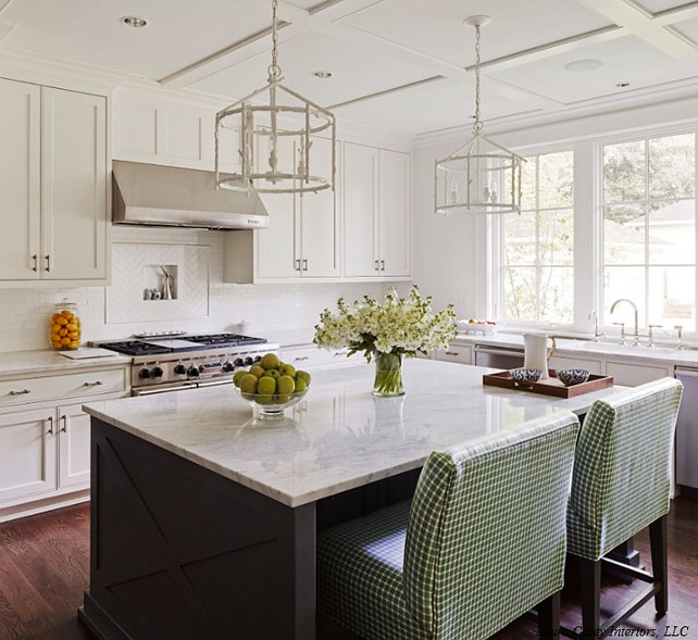Kitchen Island. KItchen Island with X Mullion Trim. A pair of Made Goods Trina Chandeliers hung from board and batten trimmed ceilings.  #Kitchen #KitchenIsland #XMullion
