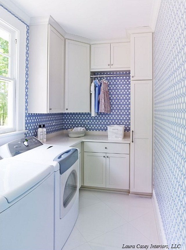 Laura Casey Interiors. Laundry Room. Laundry room with washer and dyer below window beside off-white shaker cabinets accented with brushed nickel pulls and off-white counters below a tension rod drying rack framed by David Hicks Hex Wallpaper over diamond laid floor tile. #LaundryRoom #LaundryRoomDesign #LaundryRoomIdeas