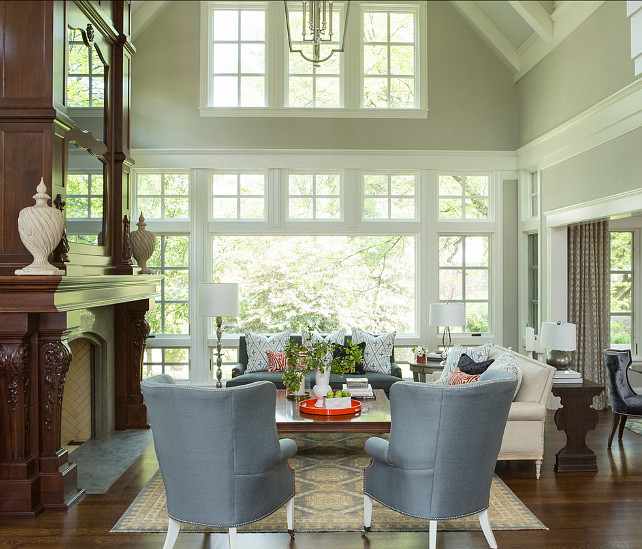 "Living Room. Living Room Ideas. Formal living room with stylish furniture. Chairs are the ""Preston Chair from Lillian August"". Great living room furniture layout. Paint Color is Benjamin Moore Revere Pewter HC-172 #LivingRoom #LivingRoomIdeas #LivingRoomLayout #LivingRooFurnitur"