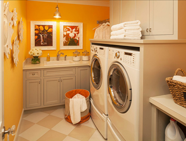 Laundry Room Ideas. The wall paint color is Benjamin Moore Sweet Orange 2017-40. The gray cabinet paint color is Benjamin Moore Smoke Embers 1466 #LaundryRoom #PaintColor #LaundryRoomIdeas