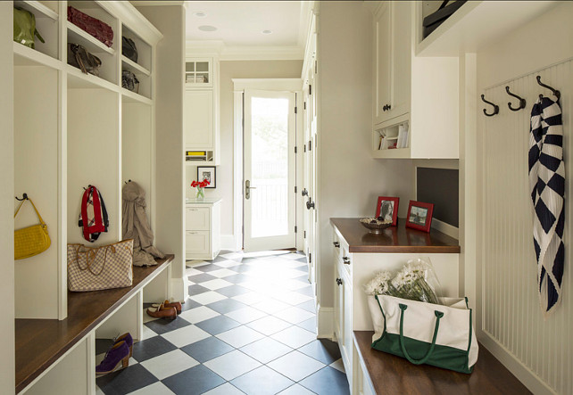 Mudroom Design. Great mudroom design with storage ideas. Paint on walls is Revere Pewter HC-172 by Benjamin Moore. #Mudroom #MudroomStorage #MudroomCubbies #MudroomIdeas