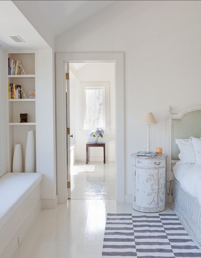 Painted Hardwood Floors. Bedroom with white painted hardwood floor. The ceilings and walls are Benjamin Moore 967 (cloud white) and the trim is Benjamin Moore 968 (dune white). #PaintedFloors #PaintedHardwoodFloor