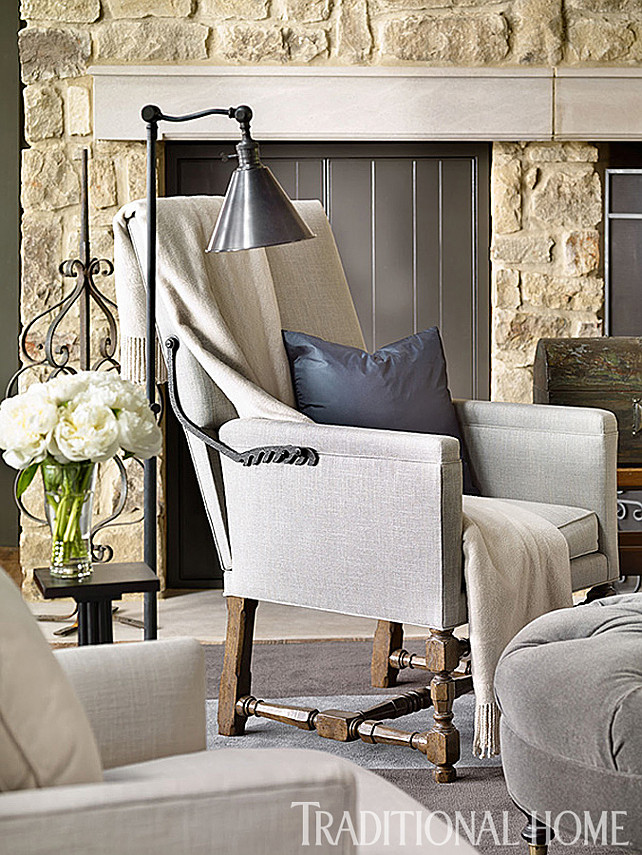 "Pineo. #LivingRoom Living Room Furniture Ideas. Hand-forged iron ratchets accent the ""Lyon"" chairs from Gregorius/Pineo. Chair fabric: ""Mica""/Pewter #10209-099 by Mokum. Pillow in chair: ""Argentina"" #1015/002 from Dedar. Throw is from Bloomingdale's. Floor lamp is the""Boston Floor Lamp"" #SL1900 from Circa Lighting. #LivingRoomFurniture"