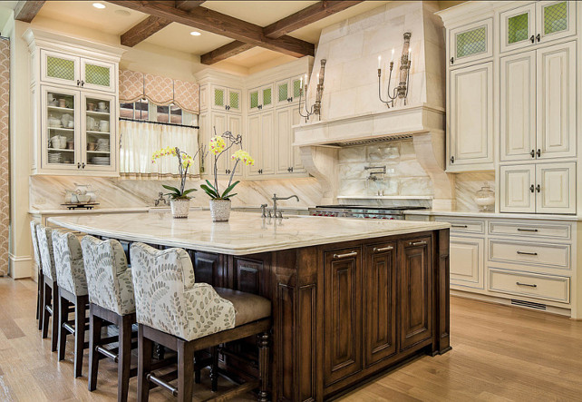 Traditional French Kitchen. French Traditional Kitchen Design. The countertop and backsplash are both marble. French Kitchen