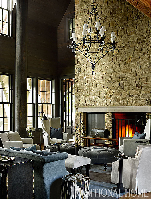"Rustic Lodge Interior Ideas. The interiors of this rustic lodge are tailored and well designed. A stone fireplace adds interest and scale to this living room. Also notice the cozy furniture layout. Pair of tufted ottomans are the ""Leather Cocktail Ottoman"" #L1014-90, and ottoman fabric (""Flanders""/Coal), both from Lee Industries. #Interiors #RusticInteriors #Lodge #Homedecor"