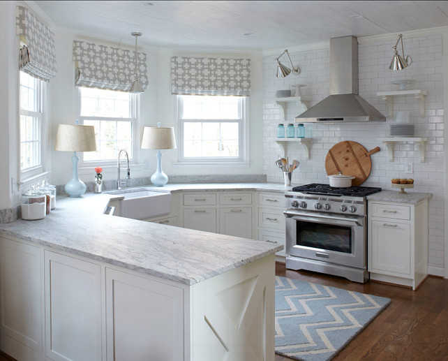 "Small Kitchen. Small Kitchen Deisgn Ideas. The countertop in this kitchen is honed ""thunder white granite"". Lisa Gabrielson Design."