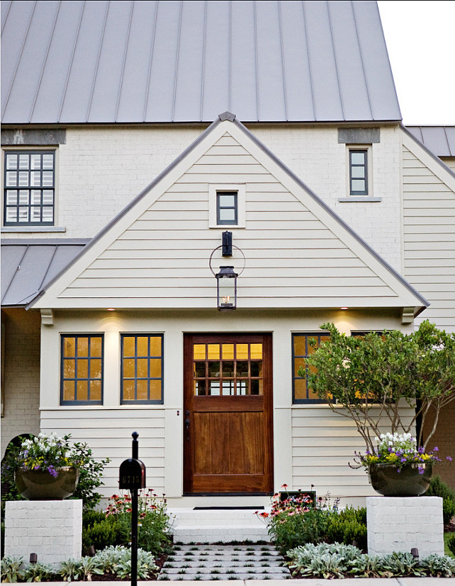 Sherwin Williams Paint Colors. Exterior Paint Color Ideas. House Paint Color is Sherwin Williams SW 6148 Wool Skein. The all wood windows are painted in Sherwin Williams Rock Bottom SW7062