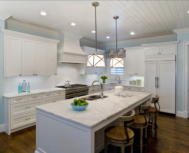 White Kitchen Design. White Kitchen with white marble countertop and turquoise decor. Studio M Interior Design, Inc.