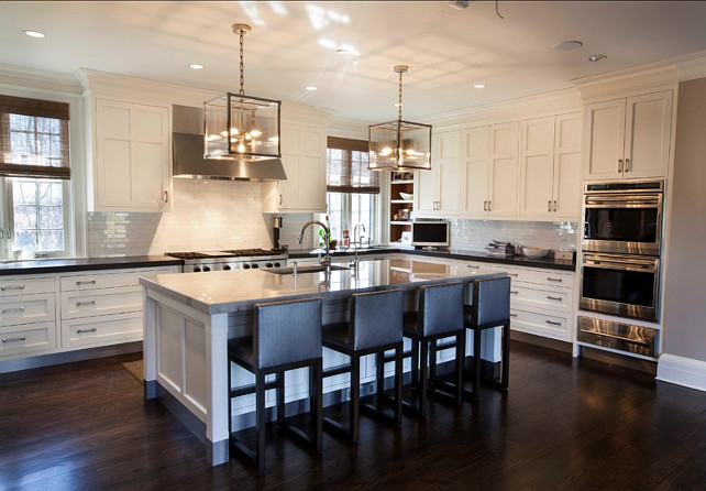 White Kitchen. Transitional White Kitchen with Dark stained Hardwood Floors. #WhiteKitchen #Kitchen #TransitionalKitchen Designed by John Johnstone Kitchen & Bath Designers.