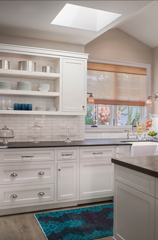 White Kitchen. White Kitchen Ideas. White kitchen cabinets with black honed granite countertop