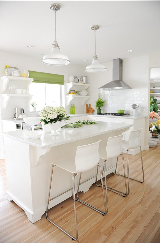 White Kitchen. White kitchen with open shelves, kitchen island, white quartz countertop, white paint color. White Kitchen Cabinets. #WhiteKitchen #Kitchen Maria Killam Interior Designers & Decorators.