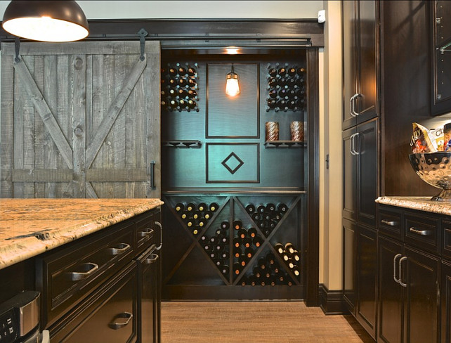 Wine Cellar Ideas. This bar has a great wine storage, which is perfect if you don't have space for a real wine cellar at home. #WineCellar #WineRoom #WineSpaces #WineCabinets #WineStorage