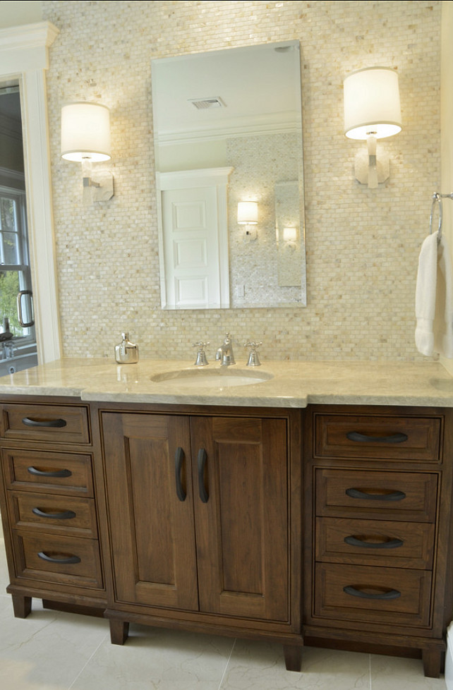 Bathroom Tiling. Mosaic mother of pearl tile on walls. Quartzite countertops. Studio Dearborn